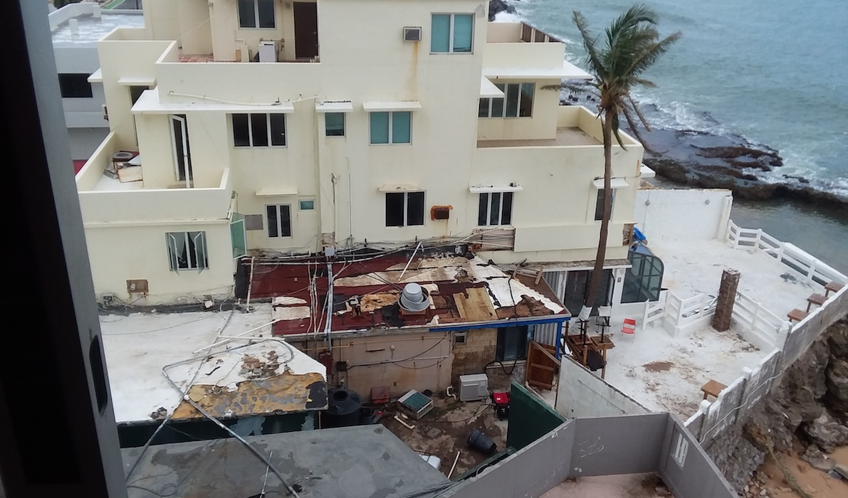 Rooftop view of debris and destruction