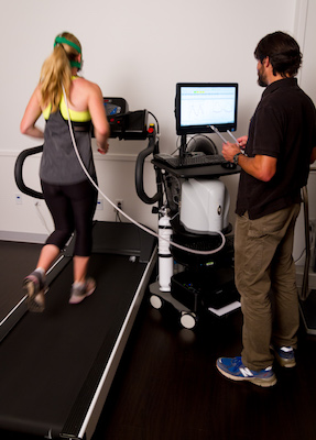 Chris Lundstrom, Ph.D., M Health, UMN CEHD helps a runner determine her aerobic fitness.