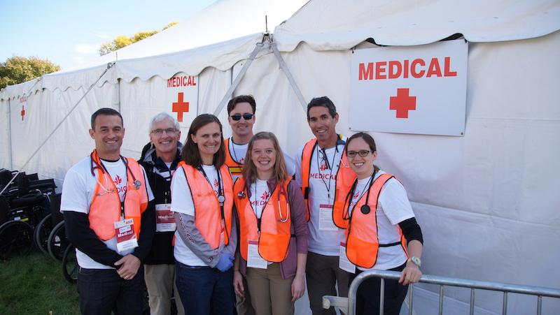 A group of medical providers volunteer at the Twin Cities Marathon