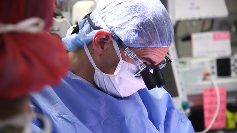 Daniel Saltzman, M.D., assists in the twins' separation surgery