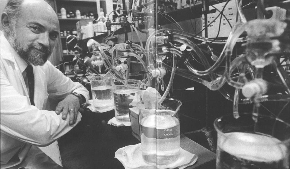 research in front of tubes and vials
